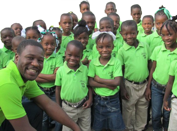 A teacher and students at the TeacHaiti School of Hope.
